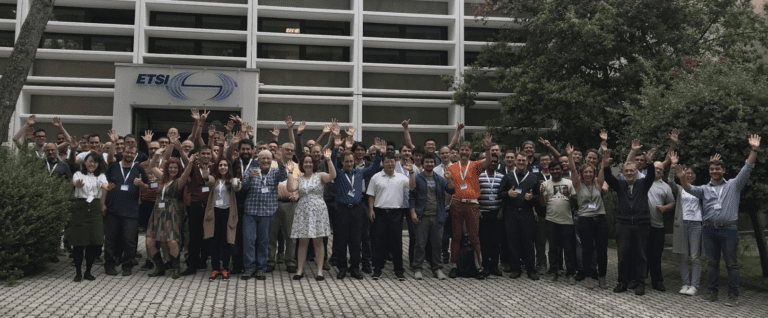 OPNFV attendees raising arms